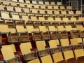 Auditorium collegezaal stoel